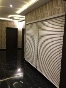 white wooden blinds in corridor